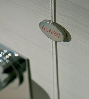 Shower alarm tag in polished steel