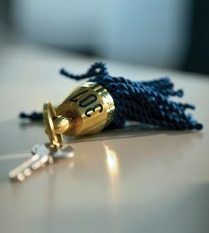 Hotel tassel key fob in metal