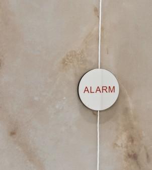Shower alarm tag in polished steel