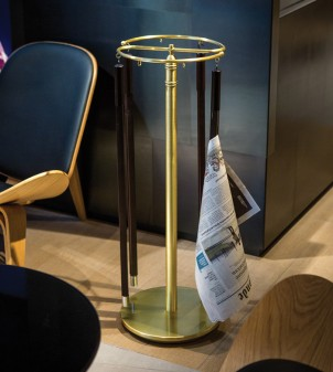Classically styled newspaper holder in round tubing.