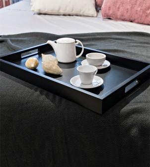 Room service tray made of dark wood