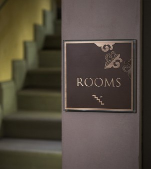 Hotel room number signs in crystal glass and burnished brass
