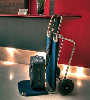 Folding hotel luggage cart lined with carpeting