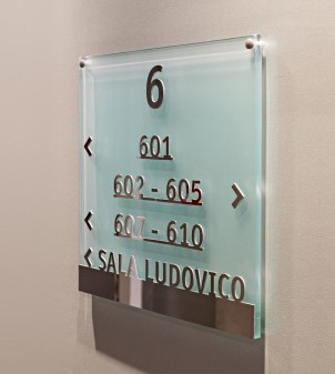 Braille signs in frosted glass with lettering in relief