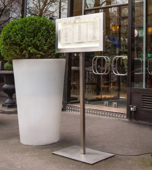 Illuminated outdoor menu stand with lock