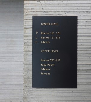 Painted brass wayfinding signs