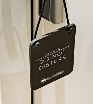 Leather do not disturb sign