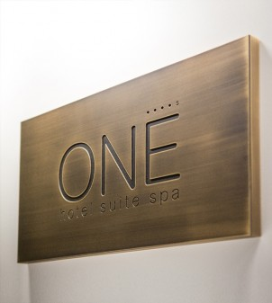 Brass plaques in aged metal for external use