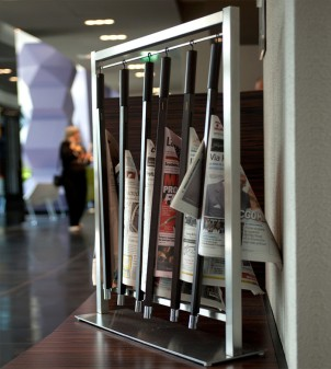 Newspaper stand in stainless steel complete with six wooden newspaper rods