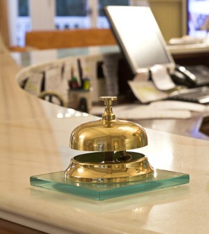 Desk bell with base in glass