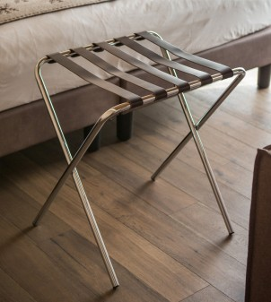 Folding luggage stand in polished chromed metal